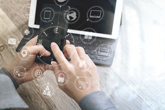 Hand using mobile payments online shopping,omni channel,icon customer network,in modern office wooden desk, graphic interface. Screen,eyeglass,filter stock images