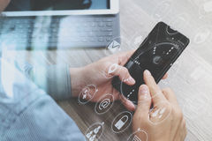 Hand using mobile payments online shopping,omni channel,icon customer network,in modern office wooden desk, graphic interface. Screen,eyeglass,filter royalty free stock photography