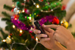 Hand using mobile smart phone with colorful ligh Royalty Free Stock Photo