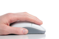 Hand Using Mouse. A young female's hand using a white computer mouse Royalty Free Stock Image