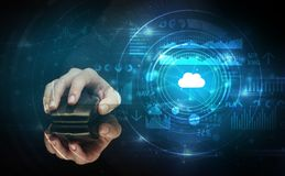 Hand using mouse with cloud technology concept. Hand using wireless mouse with cloud technology concept and dark background Royalty Free Stock Photo