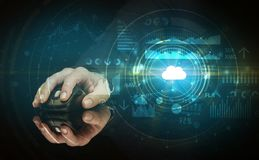 Hand using mouse with cloud technology concept. Hand using wireless mouse with cloud technology concept and dark background stock image