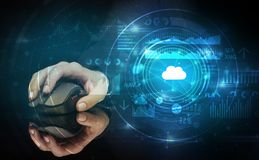 Hand using mouse with cloud technology concept. Hand using wireless mouse with cloud technology concept and dark background royalty free stock image