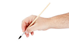 Hand using paint brush Royalty Free Stock Photos