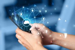 Hand using phone with centralized linked cloud system concept. Hand using phone with centralized cloud computing system and network security concept royalty free stock photos
