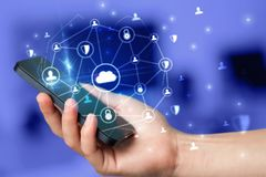 Hand using phone with centralized linked cloud system concept. Hand using phone with centralized cloud computing system and network security concept royalty free stock images