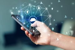 Hand using phone with centralized linked cloud system concept. Hand using phone with centralized cloud computing system and network security conceptn royalty free stock photos