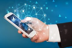 Hand using phone with centralized linked cloud system concept. Hand using phone with centralized cloud computing system and network security concept stock image
