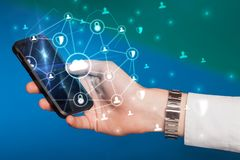 Hand using phone with centralized linked cloud system concept. Hand using phone with centralized cloud computing system and network security conceptn royalty free stock image