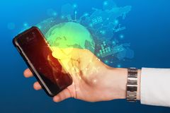 Hand using phone  with worldwide reports links and statistics co. Hand using phone with global reports and stock market change concept Stock Images