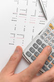 Hand using scientific calculator for business Stock Photos