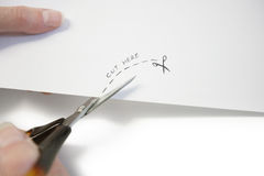 Hand using scissors to cut paper Royalty Free Stock Photo