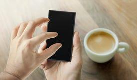 Hand using smart phone Stock Photo