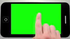 Hand using smartphone with green screen. Digital animation of Hand using smartphone with green screen stock footage
