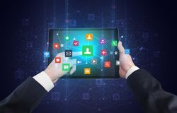 Hand using tablet with bounce application symbols concept. Hand using tablet with colorful bounce application symbols and icons concept stock photo