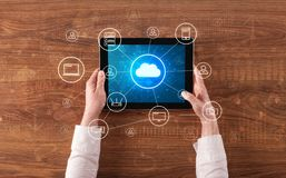 Hand using tablet with centralized cloud computing system concept. Hand touching tablet with cloud computing and online storage concept royalty free stock photo