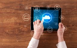 Hand using tablet with centralized cloud computing system concept. Hand touching tablet with cloud computing and online storage concept royalty free stock photos