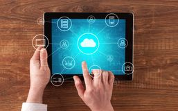 Hand using tablet with centralized cloud computing system concept. Hand touching tablet with cloud computing and online storage concept stock photo