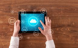 Hand using tablet with centralized cloud computing system concept. Hand touching tablet with cloud computing and online storage concept royalty free stock image