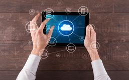Hand using tablet with centralized cloud computing system concept. Hand touching tablet with cloud computing and online storage conceptn royalty free stock photos