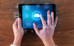 Hand using tablet with centralized cloud computing system concept. Hand touching tablet with cloud computing and online storage concept stock photography