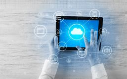 Hand using tablet with centralized cloud computing system concept. Hand touching tablet with cloud computing and online storage concept royalty free stock images