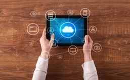 Hand using tablet with centralized cloud computing system concept. Hand touching tablet with cloud computing and online storage conceptn stock photos