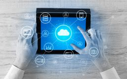 Hand using tablet with centralized cloud computing system concept. Hand touching tablet with cloud computing and online storage conceptn vector illustration