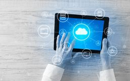 Hand using tablet with centralized cloud computing system concept. Hand touching tablet with cloud computing and online storage conceptn royalty free stock photo