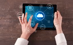 Hand using tablet with centralized cloud computing system concept. Hand touching tablet with cloud computing and online storage conceptn stock photo