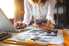 Hand using tablet ,laptop, and holding smartphone with credit card online banking payment communication network, royalty free stock photo