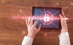 Hand using tablet with network security and online storage system concept. Hand touching online network security button and cloud, connection and contact concept stock images
