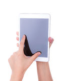Hand  using a touch screen device against Stock Photo