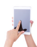 Hand using a touch screen device. Royalty Free Stock Image