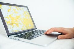 Hand using touchpad on laptop Royalty Free Stock Images