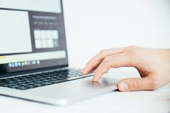 Hand using touchpad on laptop Royalty Free Stock Photography