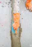 Hand using trowel at construction site Royalty Free Stock Photography