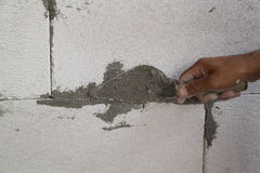 Hand using trowel with wet concrete to plastering lightweight Co Stock Photography
