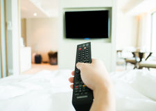 Hand using tv remote control Royalty Free Stock Photo