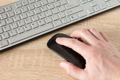 Hand using wireless computer mouse Royalty Free Stock Photo