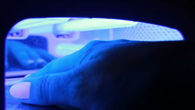 Hand in UV Lamp Nail Dryer. Woman Drying Nails. stock video footage