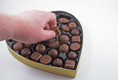 Hand with valentine chocolate Royalty Free Stock Photo