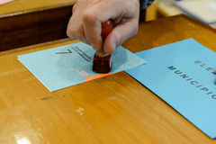 Hand  validating a voting ballot at the municipal election Royalty Free Stock Images