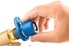 Hand on a valve Royalty Free Stock Photography