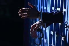 Hand van de bedrijfsmens in gevangenis Royalty-vrije Stock Foto's