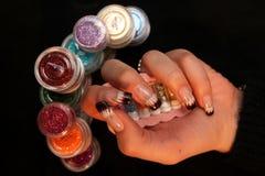 Hand van de de manicurereeks van de vrouwenholding Royalty-vrije Stock Afbeelding