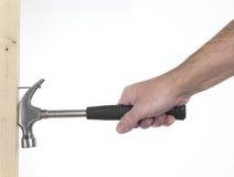 Hand van de mens met hamer Stock Afbeelding