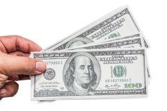 Hand van een mens die een gewaaide handvol van dollar 100 houden Stock Foto