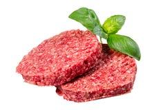 Hand - van Fijngehakt die Rundvlees, de pasteitjes wordt van Varkensvleesburgers op witte achtergrond worden geïsoleerd gemaakt d royalty-vrije stock afbeelding