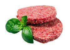 Hand - van Fijngehakt die Rundvlees, de pasteitjes wordt van Varkensvleesburgers op witte achtergrond worden geïsoleerd gemaakt d royalty-vrije stock foto's